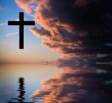 Cross silhouette against sky. Conceptual image.