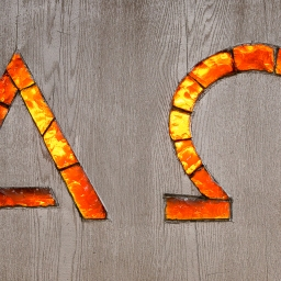 Alpha and Omega Signs in glass.